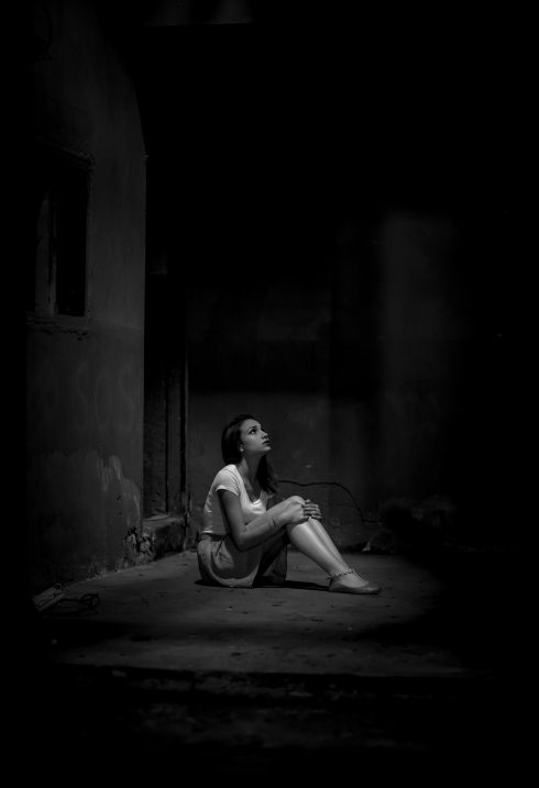 monochrome-photo-of-woman-sitting-on-floor-2223064